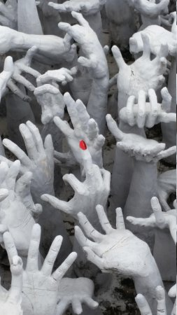 Wat Rong Khun: hands asking for help