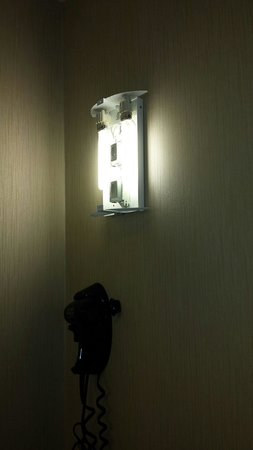 Comfort Suites: Light fixture in bathroom missing. ..very disappointed.