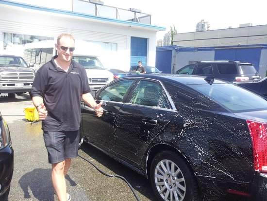 Luxury Transport - Day Tours: Rob Moseley, Owner, helping wash.