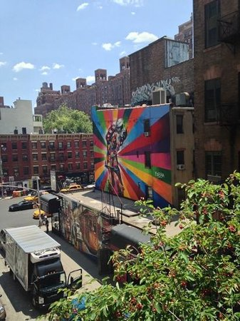 A colourful mural seen from The High Line.