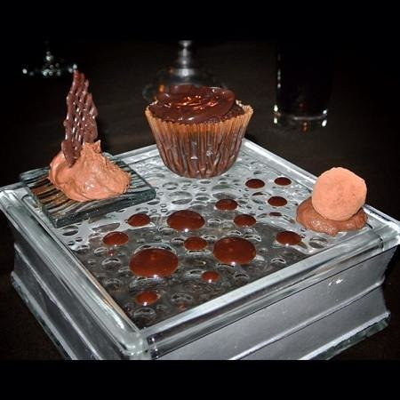 Uchu Peruvian Steakhouse: chocolate mousse, chocolate cupcake/soufflé with molten chocolate center & chocolate truffle cov