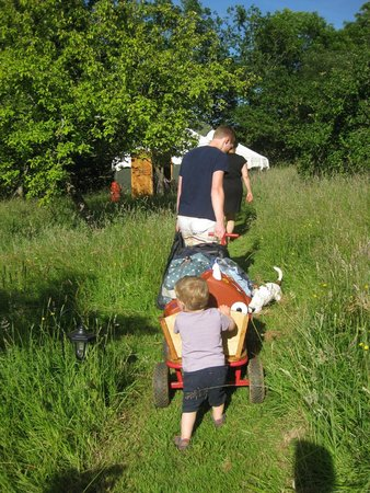 The Orchard Retreat: Taking bags to our yurt in the handy cart provided