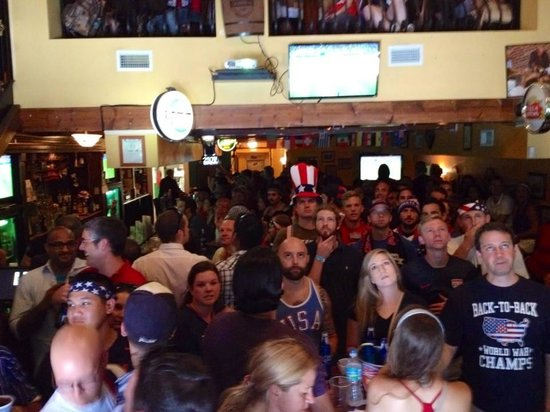 The Harp and Celt Irish Pubs and Restaurant: USA fans watching the USA vs Belgium Game at the Harp and Celt