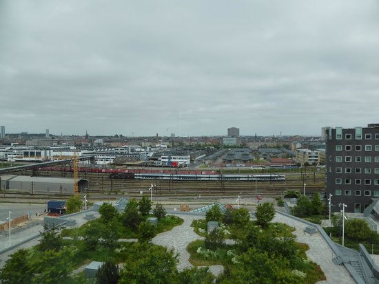 Tivoli Hotel: View of the roof terrace garden and beyond from our 8th floor room.  The grey building on the ri