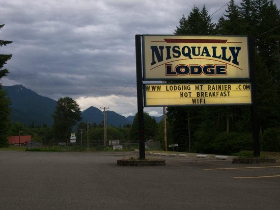 Nisqually Lodge Sign On Road In Front Of Hotel Ashford Washington