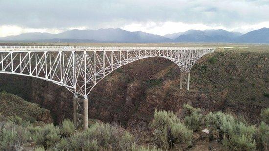 Rio Grande Gorge Bridge: Rio Grand river bridge over the gorge just before a great thunder storm.