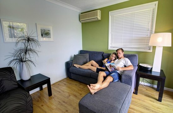 Seacove Resort : Relax in the lounge room of a one bedroom apartment.