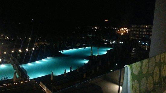 db Seabank Resort + Spa: The pool,s at night .