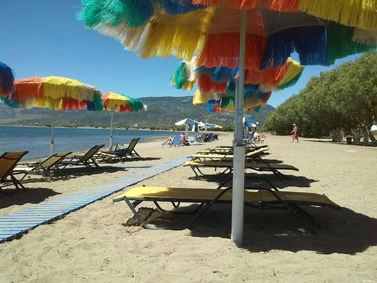 Malemi Organic Hotel: A private beach with Hawaian umbrellas