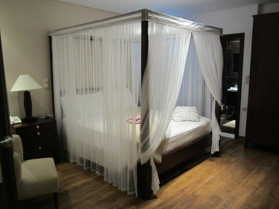 Enodia Hotel: This is the beautiful king size bed we had in our suite with a heart shape of rose pedals on it