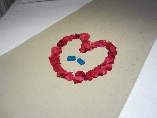 Enodia Hotel: A heart of rose pedals on the bed in our suite, all ready for our honeymoon