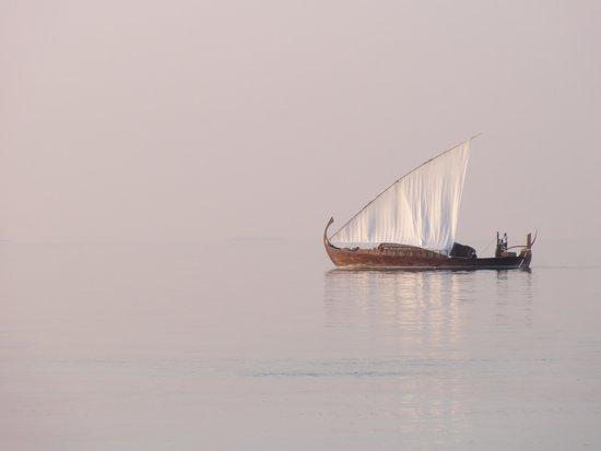 Baros Maldives: The Nooma sailing by at sunset