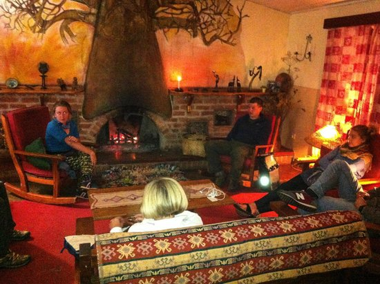 Luwawa Forest Lodge: The cosy fire in the dining room lounge