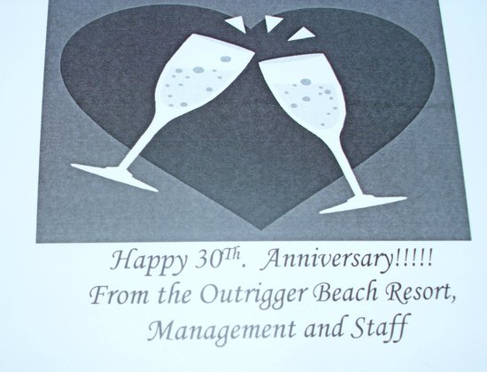 Outrigger Beach Resort: What a suprise to find this with a bottle of Champangne as we were celebrating our 30th annivers