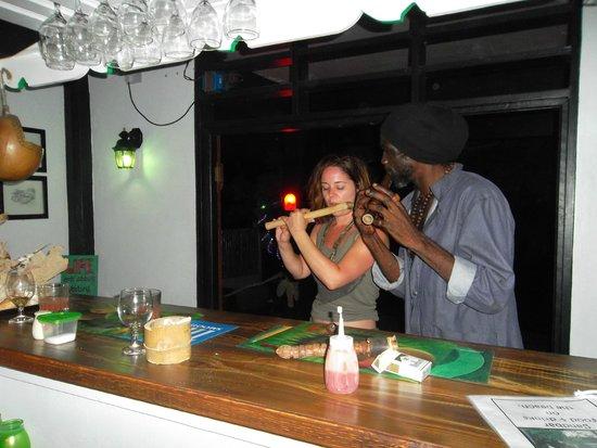 Calibishie Sandbar: Music lessons from a local man.
