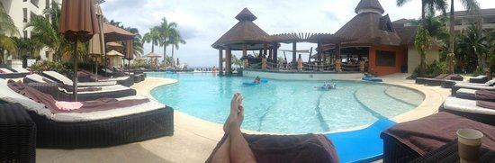 Secrets Wild Orchid Montego Bay: Shot of the swim up bar from our chair