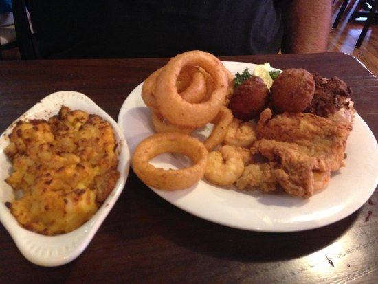 Triple Tails Oyster Bar and Grill: Seafood platter with onion rings & macaroni on side