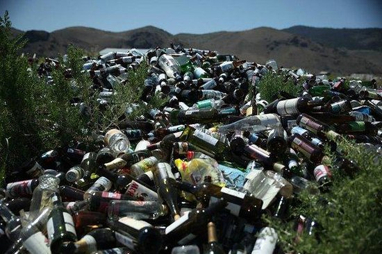 """Summer Lake Hot Springs: Glass bottle mountain found on site. Yet signs posted advise that visitors """"Leave No Trace."""" Iro"""