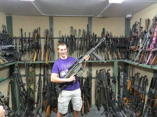 Battlefield Vegas: Alex holding a Barrett .50 cal sniper rifle in the gun vault