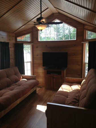 Kings Dominion Camp Wilderness Campground: Cabin Living Area with Two Futon Couches