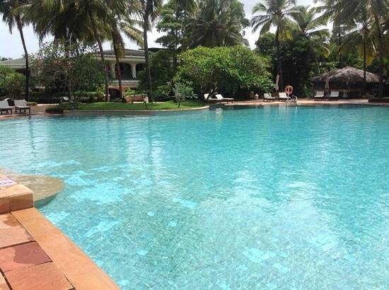 Taj Exotica Goa: pool with Main Complex in the background. bottom floor is Eugenia all day restaurant