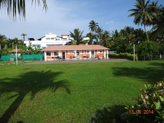 Blue Waters Cherai : Garden and pool area