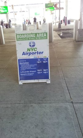 Hotel 31: NYC Airporter Signage at airport