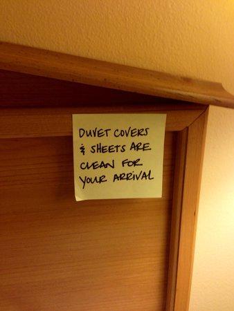 Hampton Inn & Suites New Orleans-Elmwood/Clearview Parkway Area: Hand written note on bed headboard.
