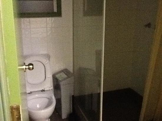 Bathroom Lights Dont Work bathroom with puddle of fluid in front of toilet - picture of