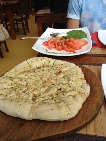 Inn Bufalito Taverna Mediterranea: rosmary focaia and tomato and mozzarla salad