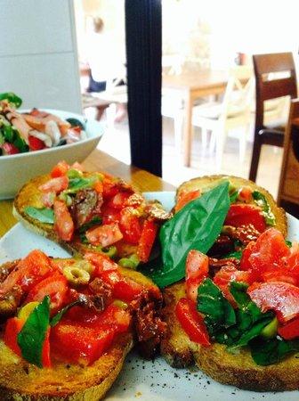 The Clock House: Vine ripe tomatoes make the best bruschetta with fresh basil!