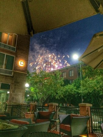 Hilton Garden Inn Chattanooga Downtown: View of the fireworks from the baseball field behind the Hilton. We were sitting on the patio at