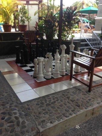 Risata Bali Resort & Spa: Giant chess set near the pool