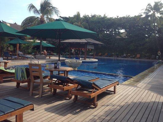 Risata Bali Resort & Spa: Pool with swim-up bar, and shallow kids pool