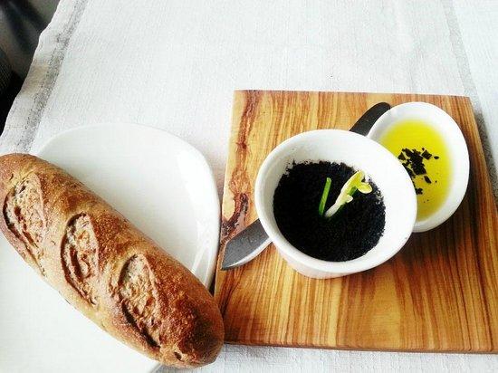 Oliva: bread with olive oil, black salt and butter, black olive powder
