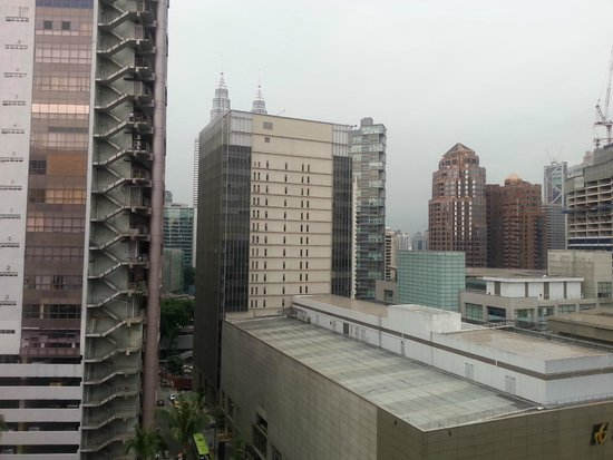 Grand Millennium Kuala Lumpur: The Petronas twin towers can be seen behind the buildings.