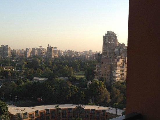 Cairo Marriott Hotel & Omar Khayyam Casino: Hotel gardens and pyramid hazy in the distance