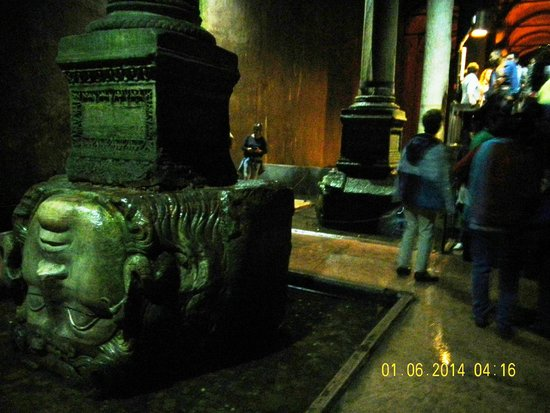 Basilica Cistern: two medisa heads in one shot  near one is upside down ,far one is tilted one .