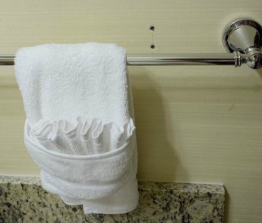 Tarrytown House Estate on the Hudson: Perfectly folded towels and high quality towel bar, but previous screw holes in wall left unfill