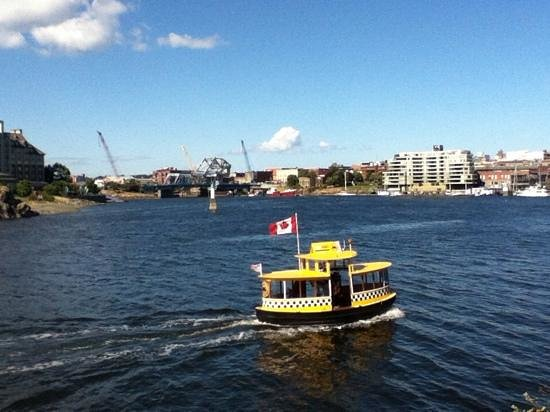 Inner Harbour: Water taxi with Johnson Street Bridge in distance.