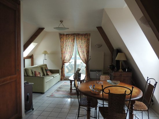 Le Manoir des Deux Amants : View of living and dining area showing the balcony.