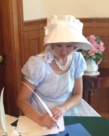 Governor's House in Hyde Park: writing with a quill pen in loby