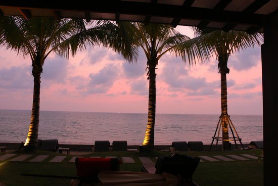 Chongfah Beach Resort: sunset from our seating area