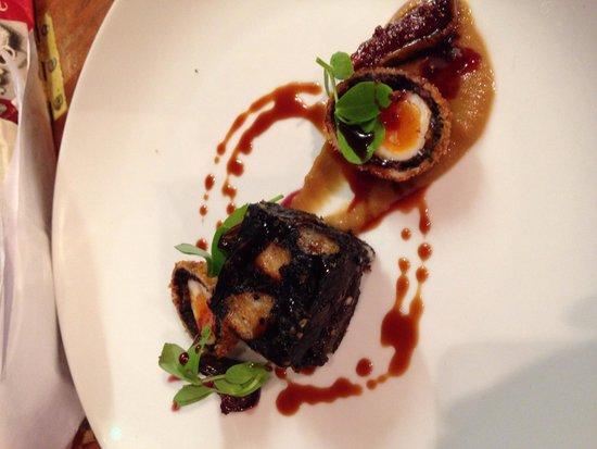 Glutton Club: Blue murder stuffed black pudding, port glazed figs, quail egg and onion purée