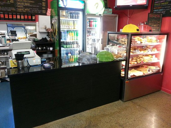 Coffee Plus cafe: Display food cabinet full with delicious savoury food and desserts