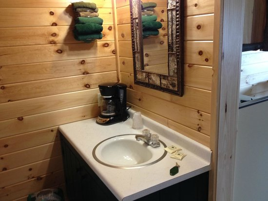 Pine Knoll Lodge & Cabins Inc : When you first walk in:  sink area across from bathroom