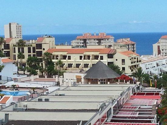 LABRANDA  Apartamentos Reveron: view from shoping centre roof top play area of bars & Reveron apts ( cream Building)