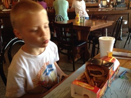 The Whistle Stop at The American Cafe': kids meal contained 2 nice cheeseburgers, fries and a drink for $5!