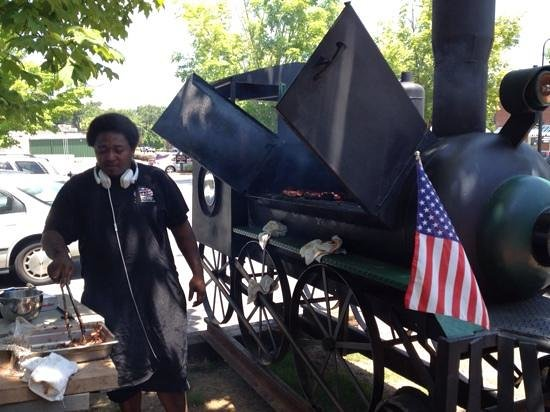 The Whistle Stop at The American Cafe': Train engine barbque and the cook! You cant go wrong!
