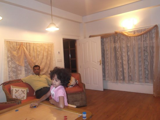 Aerodene Cottage: kids playing indoor games while adults relax